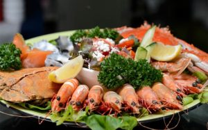 Enjoy a seafood platter overlooking the river.